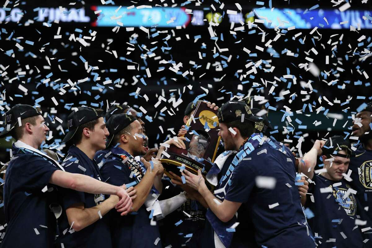 The Villanova Wildcats celebrate after defeating Michigan in the NCAA Championship game at the Alamodome. Kin Man Hui/San Antonio Express-News