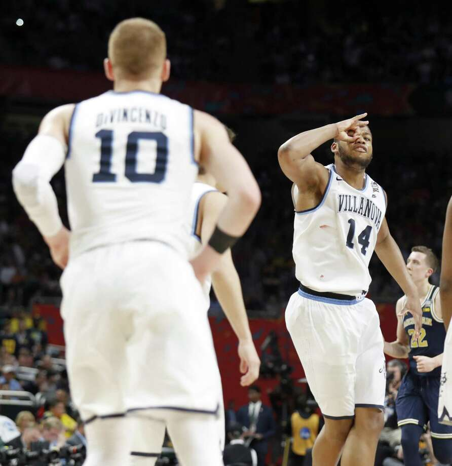 Villanova Wildcats' Omari Spellman (14) celebrate after a basket by teammate Donte DiVincenzo (10) during their NCAA Division I Men's National Championship Basketball game against the Michigan Wolverines held Monday April 2, 2018 at the Alamodome. Villanova Wildcats won 79-62. Photo: Edward A. Ornelas, Staff / San Antonio Express-News / © 2018 San Antonio Express-News