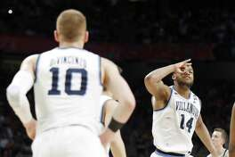 Villanova Wildcats' Omari Spellman (14) celebrate after a basket by teammate Donte DiVincenzo (10) during their NCAA Division I Men's National Championship Basketball game against the Michigan Wolverines held Monday April 2, 2018 at the Alamodome. Villanova Wildcats won 79-62.