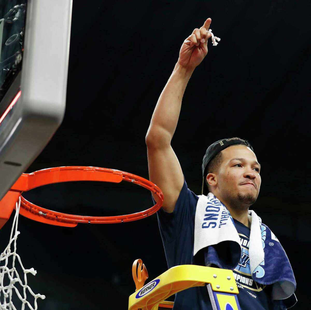 Villanova Wildcats' Jalen Brunson (1) cuts down the net after the NCAA Division I Men's National Championship Basketball game against the Michigan Wolverines held Monday April 2, 2018 at the Alamodome. Villanova Wildcats won 79-62.