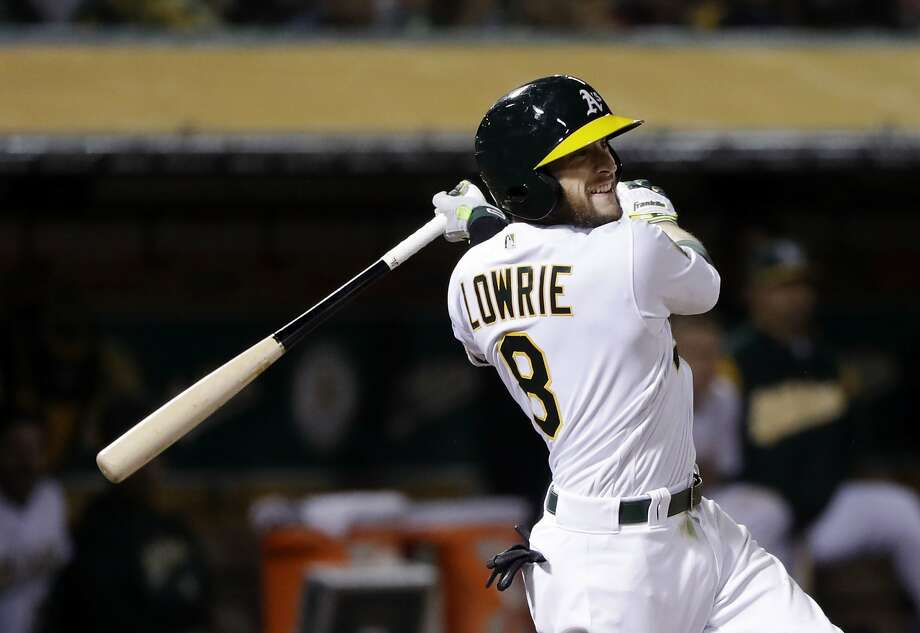 Oakland Athletics' Jed Lowrie drives in two runs with a double against the Texas Rangers during the seventh inning of a baseball game, Monday, April 2, 2018, in Oakland, Calif. (AP Photo/Marcio Jose Sanchez) Photo: Marcio Jose Sanchez, Associated Press