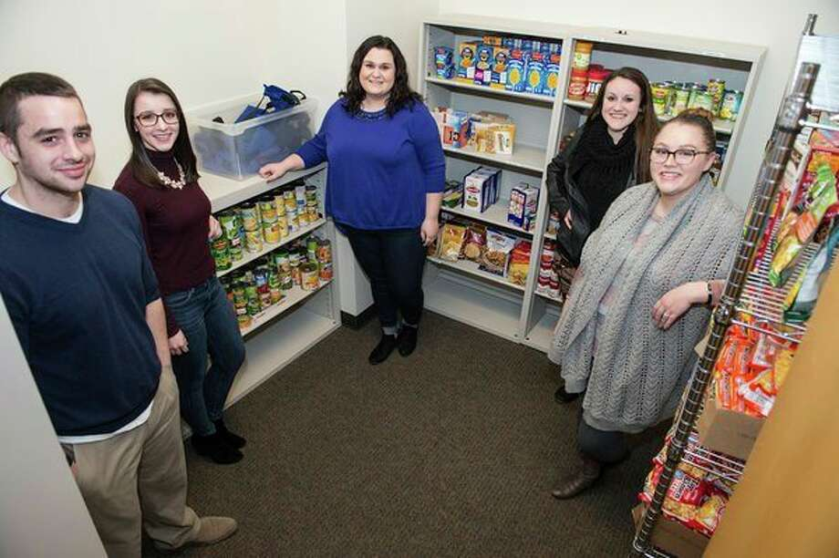 Saginaw Valley State University students have shown care and concern for their peers, working to establish a Cardinal Food Pantry to provide resources to hungry students. From left, Gerred Pease, a master of social work student from Midland; Shelby Myers, a social work major from Howell; Shelby Havens, a social work major from Snover; Katy Michaels, a social work from Howell, and Rustie Stebbins, a social work major from Saginaw. (Tim Inman/SVSU)
