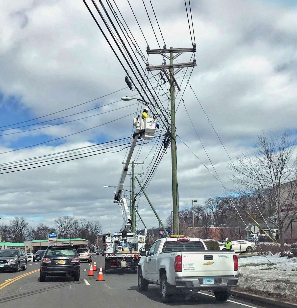 An Eversource Energy crew works on wires in March 2018 on Main Avenue in Norwalk, Conn.