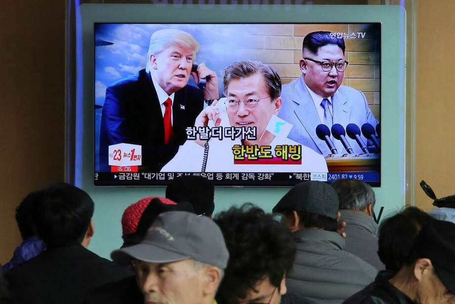 People watch a TV screen showing images of North Korean leader Kim Jong Un, right, South Korean President Moon Jae-in, center, and U.S. President Donald Trump at the Seoul Railway Station in Seoul, South Korea. Photo: Ahn Young-joon / Associated Press / Copyright 2018 The Associated Press. All rights reserved.