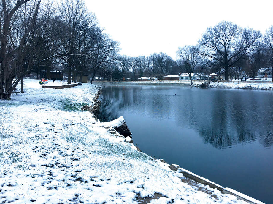 Edwardsville-area residents woke up Monday morning to snow-covered cars and temperatures in the 20s. A cold front moved in Saturday night and Sunday; April Fool's Day saw a rare early-spring snowfall. The prevalent pattern of cool temperatures, rain and little to no sun is expected to continue through the week. Photo: Bill Tucker • Btucker@edwpub.net