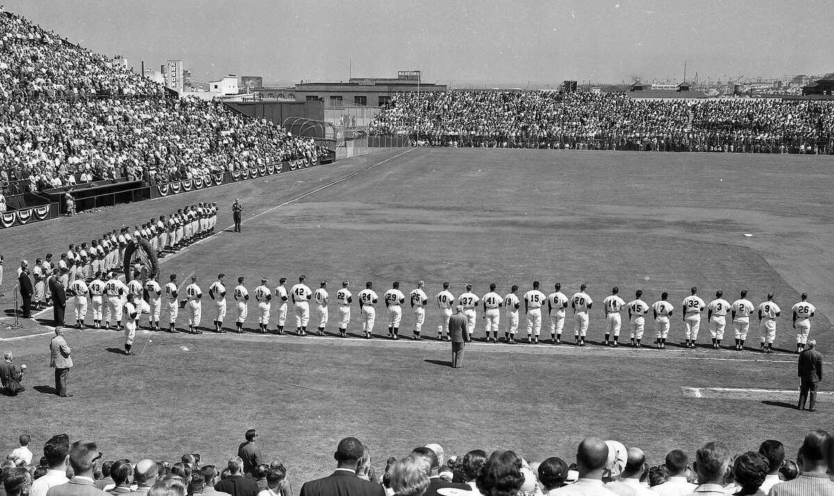 Presenting the rosters and lineups at the Giants opening game against the Dodgers, April 15, 1958