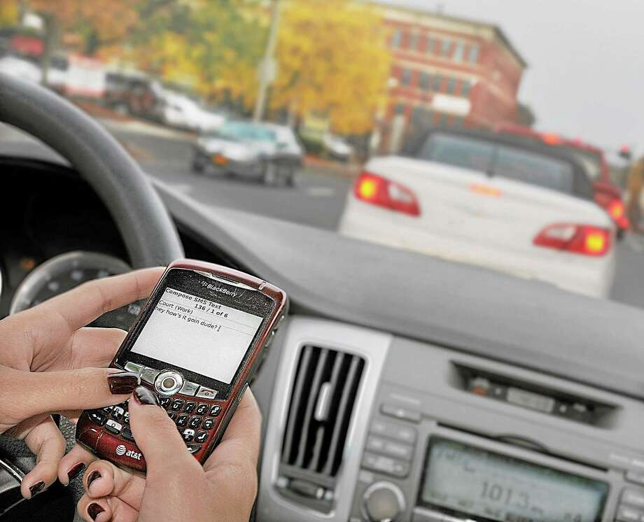 Hamden and North Haven police will crack down on distracted driving in April. Photo: Catherine Avalone / File Photo / TheMiddletownPress
