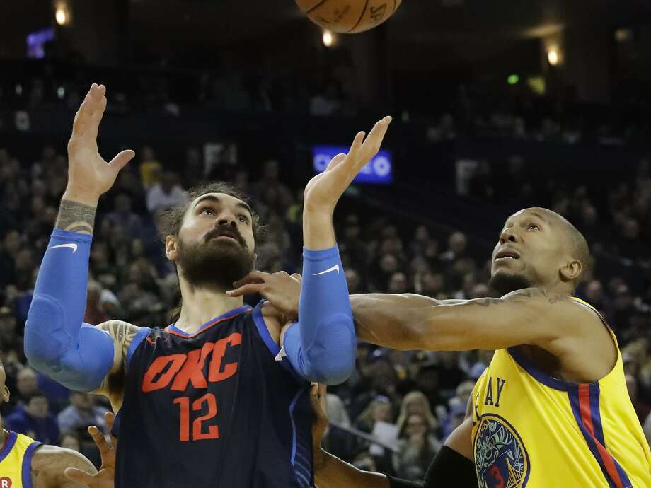 Golden State Warriors forward David West (3) pushes Oklahoma City Thunder center Steven Adams (12) for a rebound on Saturday, Feb. 24, 2018 in Oakland, CA. Photo: Paul Kuroda / Special To The Chronicle