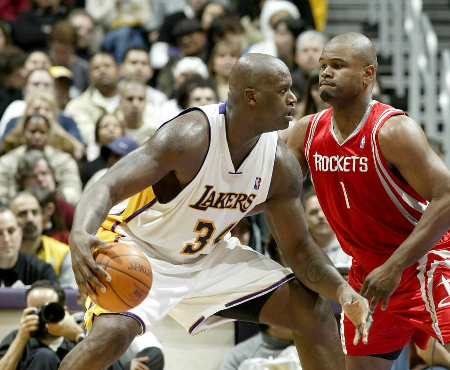 PHOTOS: Alton Ford in high school and collegeLOS ANGELES - DECEMBER 25:  Shaquille O'Neal #34 of the Los Angeles Lakers goes to the basket defended by Alton Ford #1 of the Houston Rockets on December 25, 2003 at the Staples Center in Los Angeles, California.  (Photo by Lisa Blumenfeld/Getty Images) Photo: Lisa Blumenfeld/Getty Images