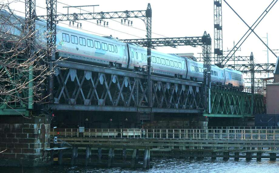 An Acela train heads toward Grand Central Terminal on the Metro-North Walk Bridge over the Norwalk River. Photo: Alex Von Kleydorff / Hearst Connecticut Media / Norwalk Hour