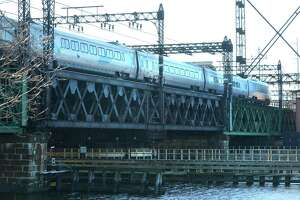 An Acela train heads toward Grand Central Terminal on the Metro-North Walk Bridge over the Norwalk River.