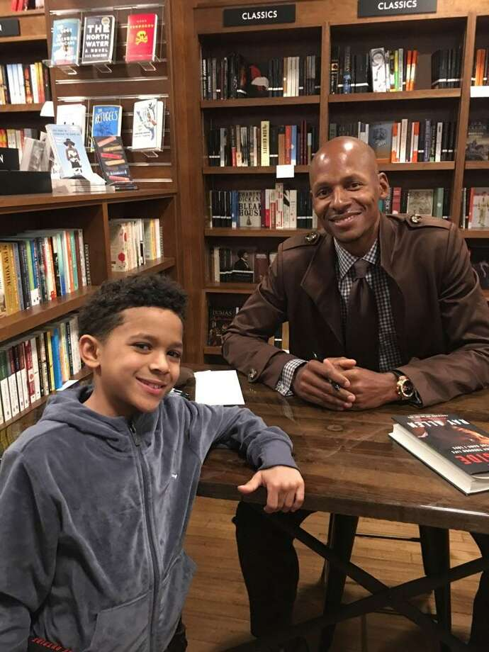"Retired NBA shooting guard Ray Allen visited the Wesleyan R.J. Julia Bookstore on Main Street in Middletown last week. His wife Shannon owns the grown cafe inside the shop. Here, Deon, 7, poses for a photograph with Allen, whose new book, ""From the Outside: My Journey Through Life and the Game I Love,"" includes a foreword by Spike Lee. It is a look at Allen's life and career, filled with behind-the-scenes stories and revelations about the game he loves. In 1998, Allen starred in Lee's ""He Got Game"" as high school phenomenon Jesus Shuttlesworth. Photo: Ernesto Vargas Photo"