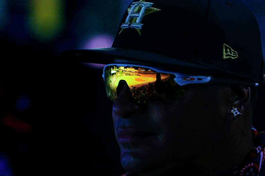 "Minute Maid Park reflects in Ruben Cardenas' sunglasses. ""I love the Astros,"" he said. ""Ever since I started watching TV, I've been watching the Astros."" Photo: Michael Ciaglo / Michael Ciaglo"