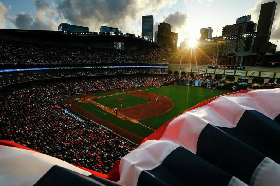 Red, white and blue bunting flaps in the wind as the sun sets over Minute Maid Park during the game. Photo: Michael Ciaglo / Michael Ciaglo