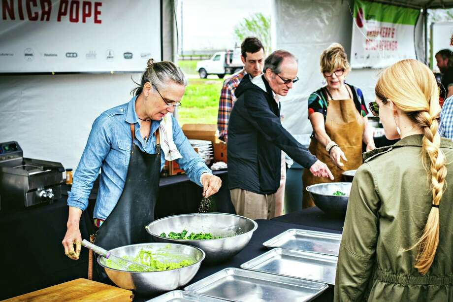 Houston chef Monica Pope adds seasoning to her kale salad during the recent Chef Fest, which raised $4,000 for four local charities. Photo: Courtesy Photo By Courtney West
