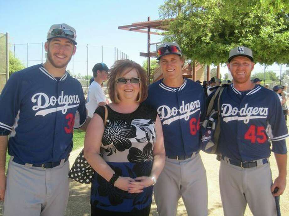 Michelle Servinski and her husband, Chuck, have hosted two Loons players each year for the past nine seasons. Here, Michelle is pictured with former Loons players, from left, Joey Curletta, Brandon Dixon, and Paul Hoenicke, at spring training in Glendale, Ariz. (Photo provided/Chuck Servinski)
