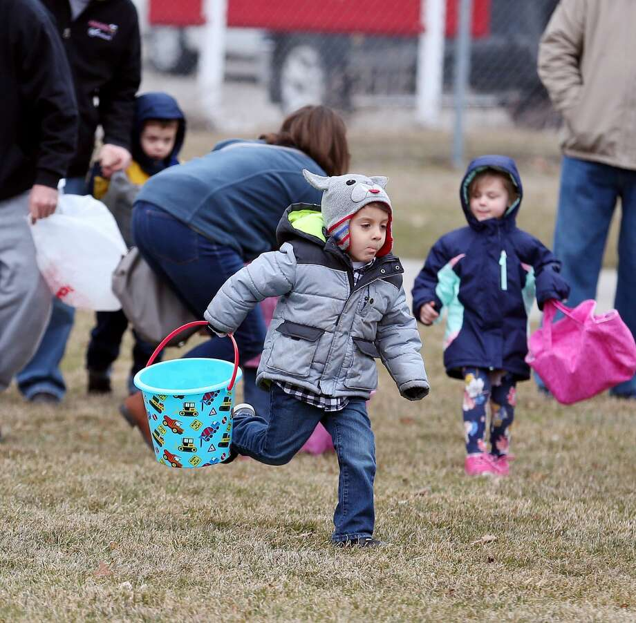 Youngsters in Pigeon, Caseville and Port Austin were able to take part in Easter egg hunts before the weather took a turn for the worse Saturnday. Photo: Paul P. Adams/Huron Daily Tribune
