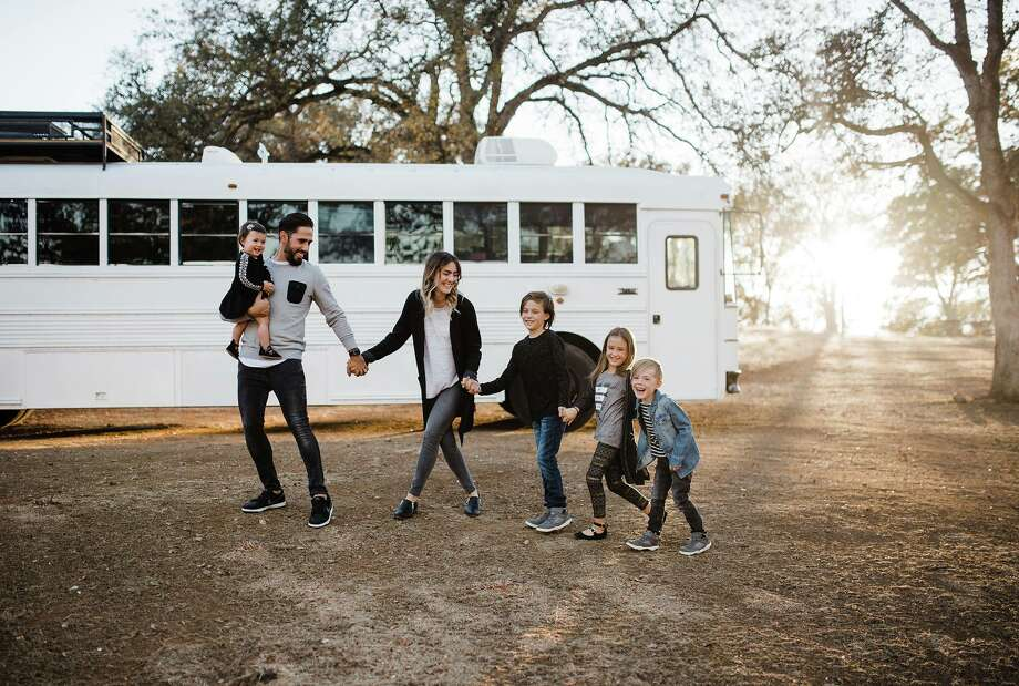 The Mayes family spent six months transforming a 17-year-old Thomas High Top school bus into their new home on wheels. Photo: Debbie Mayes