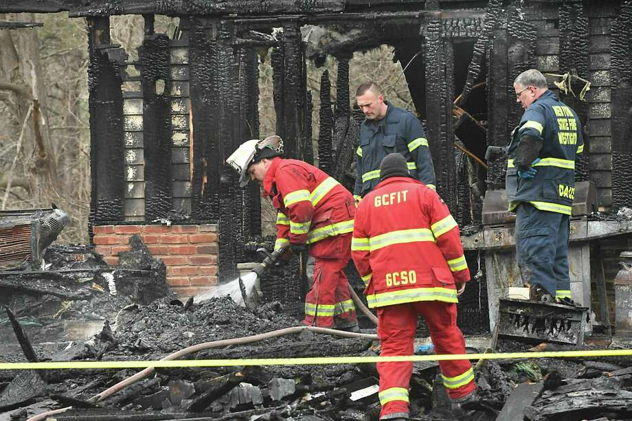 Firefighters put out hot spots in the ftermath of a tragic fire that took five lives on Rt. 145 on Tuesday, April 3, 2018 in East Durham, N.Y. Jonathan, Sophia and Jayden Mammano died, along with their grandparents, Nicholas and Mary Mammano, when fire swept through the elder Mammano's home. (Lori Van Buren/Times Union) Photo: Lori Van Buren, Albany Times Union / 20043397A