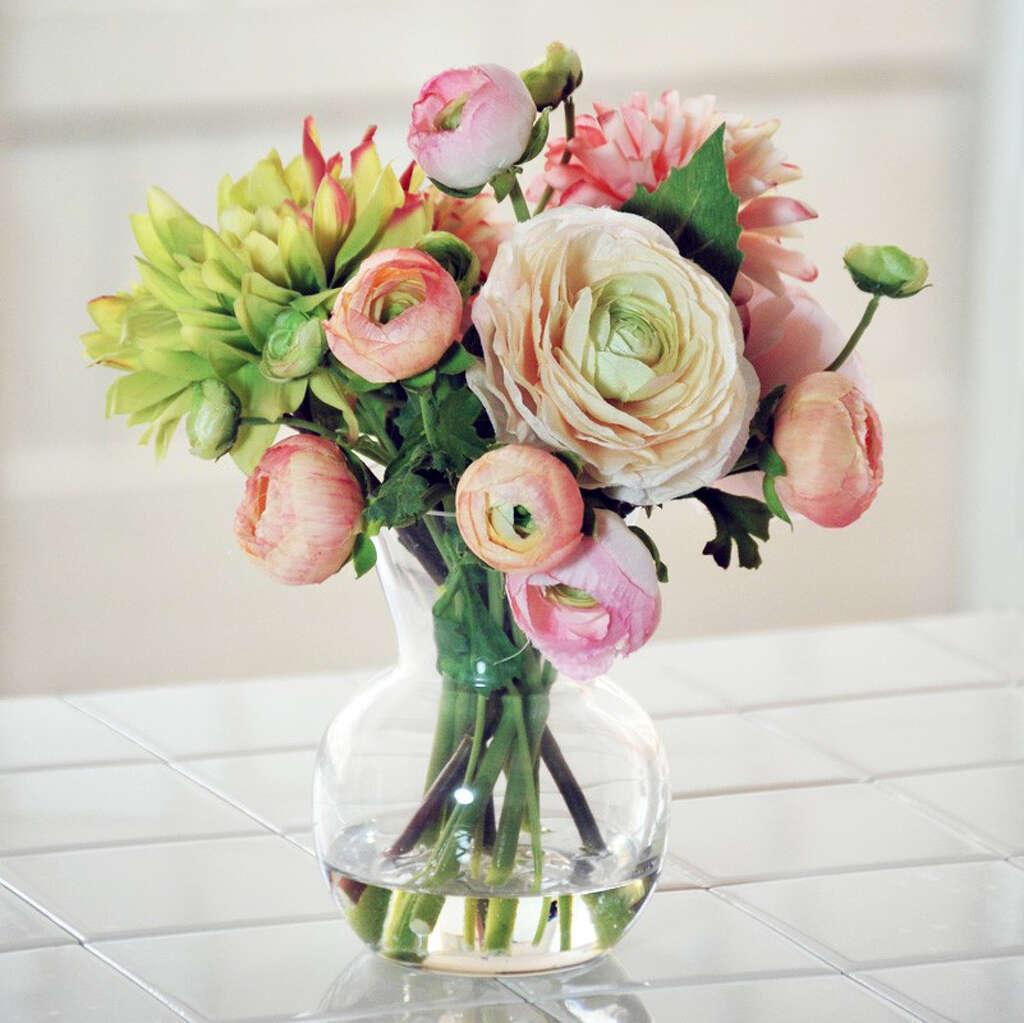 Friends of faux designers embrace fake owers sfgate a dahlia ranunculus floral arrangement in a decorative vase 19099 jossandmain reviewsmspy