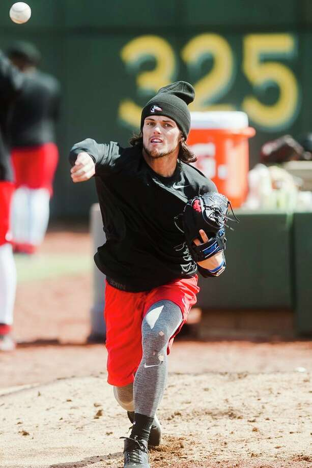 Great Lakes Loons pitcher Riley Ottesen pitches during their first practice of the season on Monday at Dow Diamond. (Katy Kildee/kkildee@mdn.net)