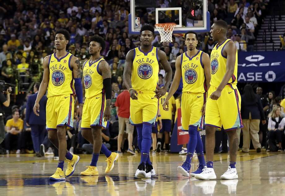 From left, Golden State Warriors' Patrick McCaw, Nick Young, Jordan Bell, Shaun Livingston and Kevon Looney during the second half of an NBA basketball game against the Milwaukee Bucks Thursday, March 29, 2018, in Oakland, Calif. (AP Photo/Marcio Jose Sanchez) Photo: Marcio Jose Sanchez / Associated Press