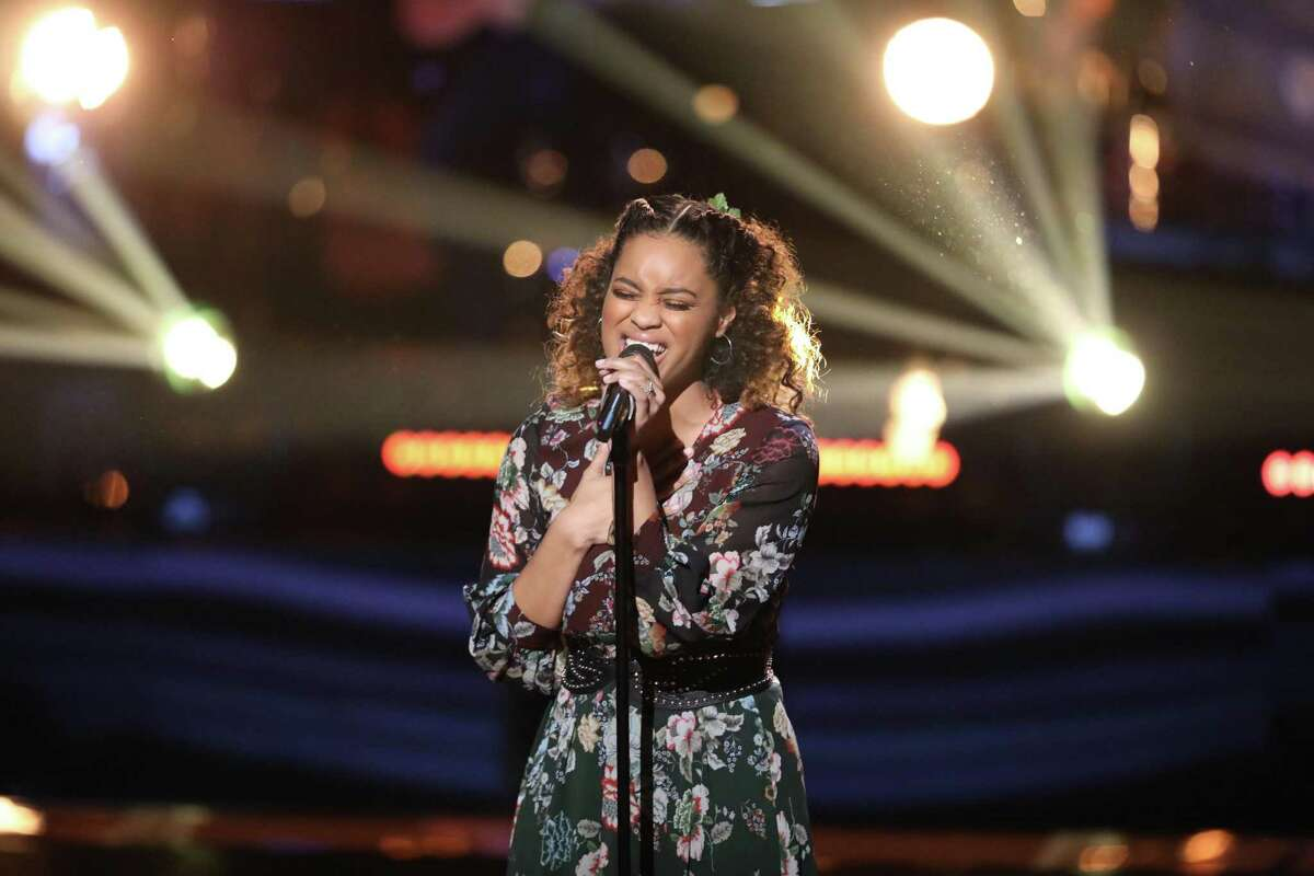 """Spensha Baker, San Antonio's singer on NBC's """"The Voice,"""" mesmerized the judges and audience with her rendition of Chris Stapleton's """"Broken Halos"""" and won her Team Blake Knockout Round, lifting her to the show's top 24."""