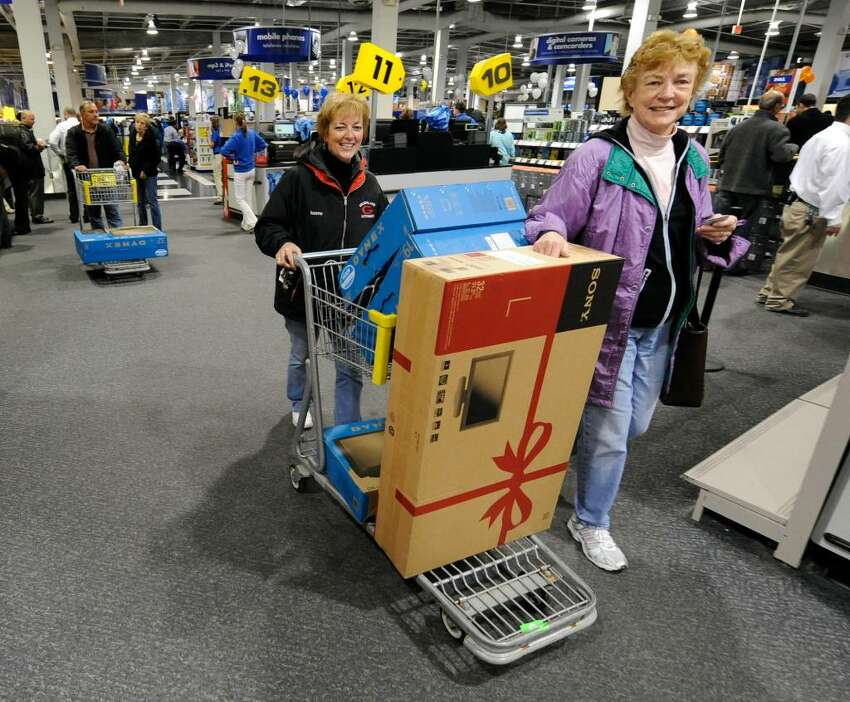 Margaret Sullivan, foreground, and Maureen Iuorno, back of cart, of Albany with a loaded cart of