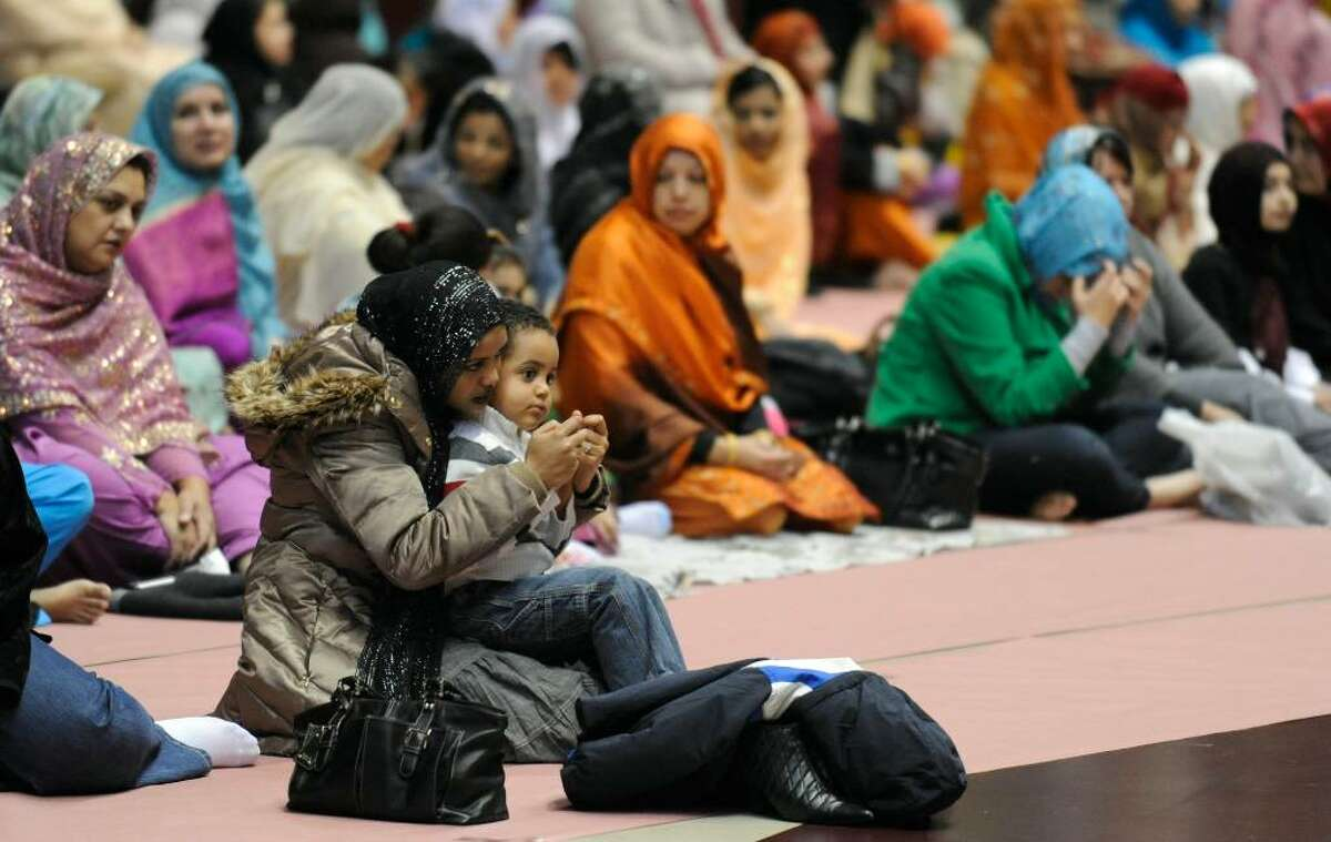Area Muslims gather Friday at the Union College Field House in Schenectady, for congregational prayers to mark Eidul Adha, the day that commemorates Abraham and marks the completion of the hajj, or pilgrimage, to Mecca. It was organized by the Islamic Center of the Capital District. (Skip Dickstein/Times Union).