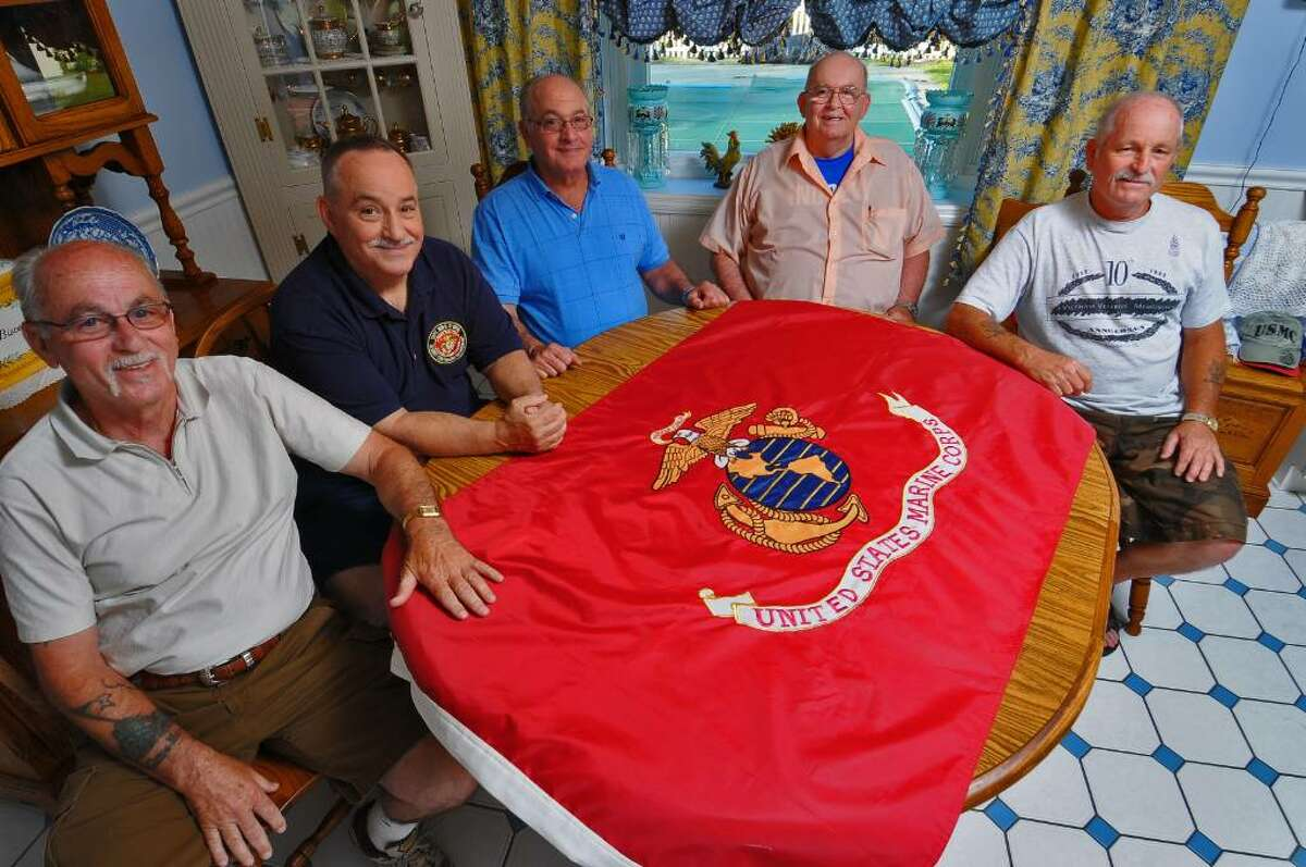 The five Nardolillo brothers, who all served in the U.S. Marine Corps, will serve as grand marshals of Albany's Memorial Day Parade on Monday. The Albany men are, from left, John, Joseph, William, Francis and Peter. They were photographed in Colonie. ( Philip Kamrass / Times Union)