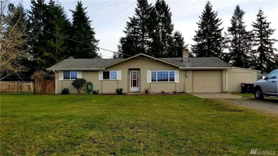 This rambler sits on more than half an acre, fully-fenced, with three-bedrooms and a wood-burning fireplace. There's also an attached garage with a workshop area, huge full bath, and a slider-door to the backyard, which has a play set and back-corner chicken coop.6721 183rd Ave. S.W., listed for $215,500. See the full listing below. Photo: Listed By Stephanie Crone • Windermere Real Estate Yelm