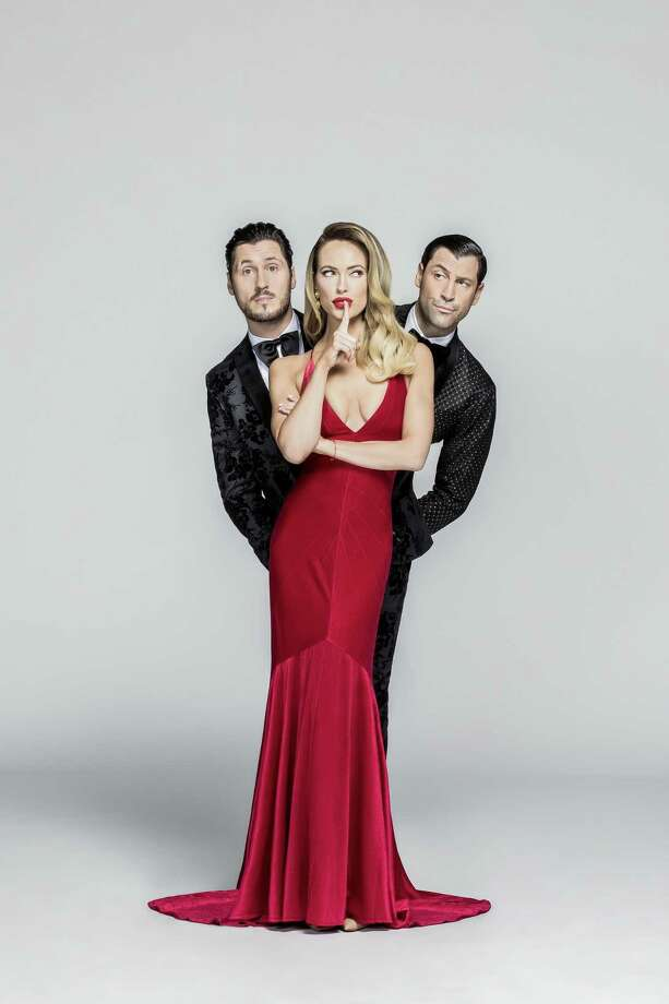 "Maksim Chmerkovskiy, right, and his wife, Peta Murgatroyd, and brother, Valentin Chmerkovskiy, of ABC's ""Dancing With the Stars,"" perform in their new show, ""Confidential,"" at Mohegan Sun Arena on April 12. Photo: Jerry Metellus Photography,  Inc. / Contributed Photo / Kevin Dyer 2017"