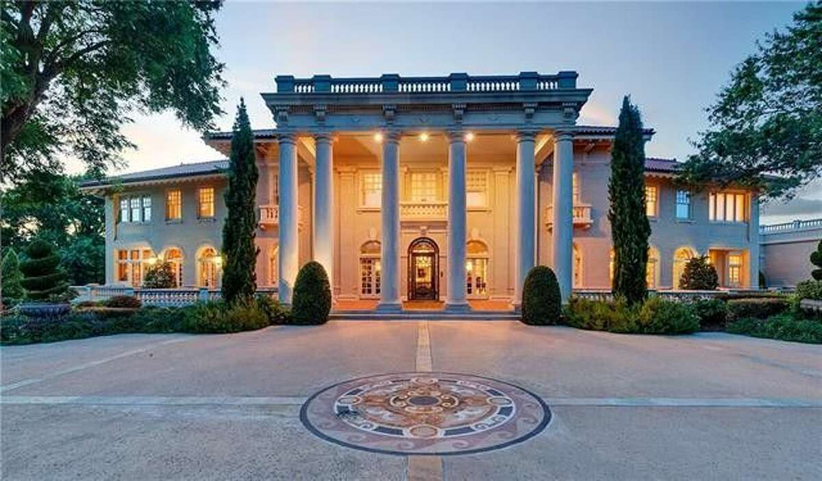 Built in the early 20th century for banker Earl Baldridge, this grand, three-story home is fashioned out of limestone and even has a bank vault in the basement.Scroll through to get a closer look at the details.