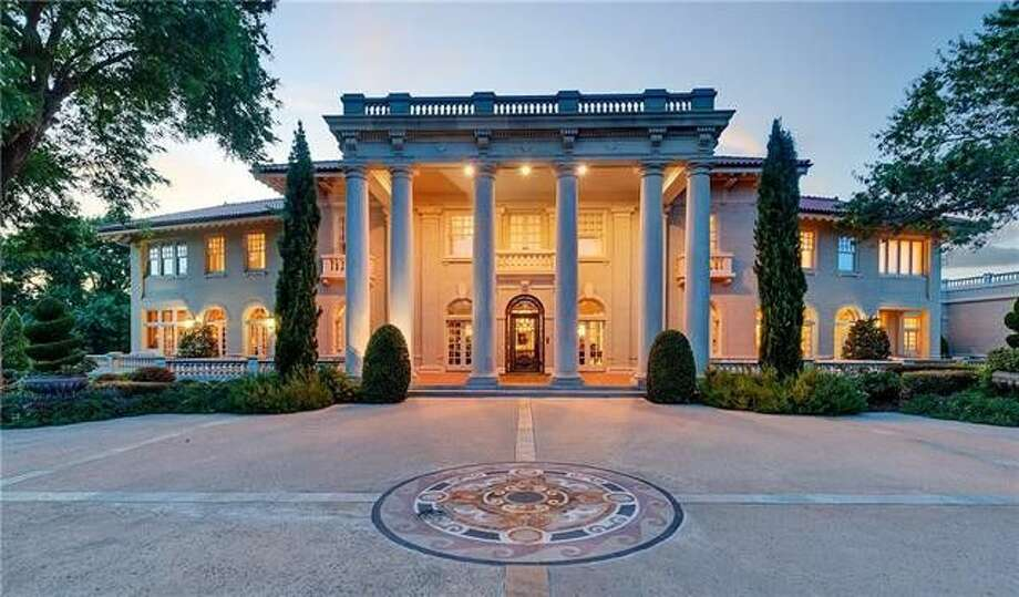 Built in the early 20th century for banker Earl Baldridge, this grand, three-story home is fashioned out of limestone and even has a bank vault in the basement.Scroll through to get a closer look at the details. Photo: Realtor.com