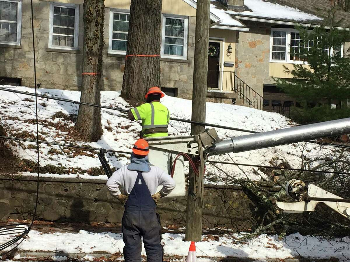 Frontier Communications crews at work in March 2018 in New Haven, Conn.