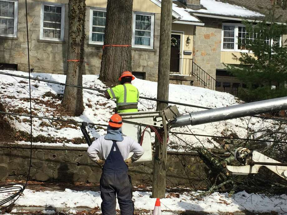 Frontier Communications crews at work in March 2018 in New Haven, Conn. Photo: William Kaempffer / Hearst Connecticut Media /