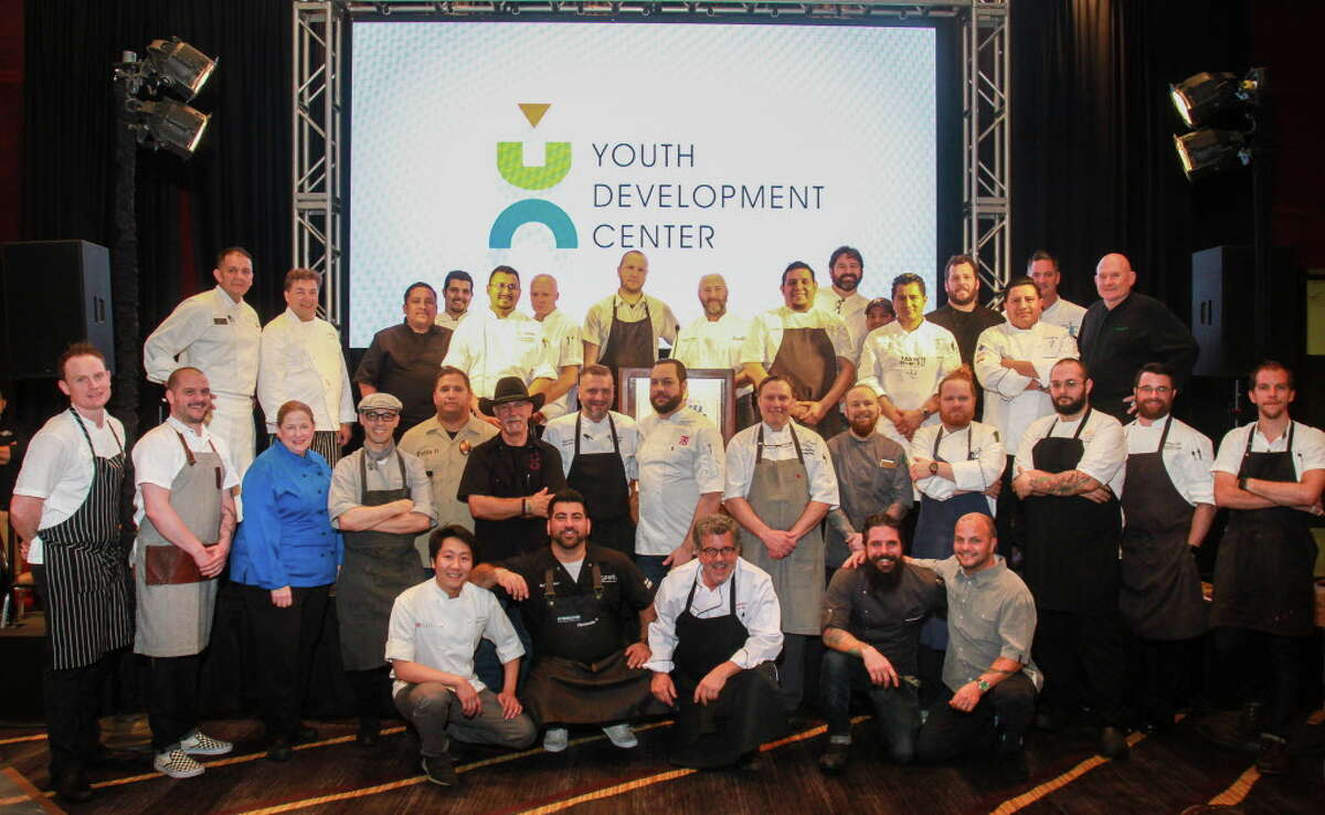 Chefs pose for group photo at the Bon Vivant Houston dinner benefiting Youth Development Center.