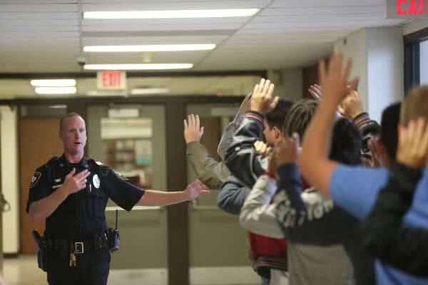Jasper High School's resource officer Josh Beckman, evacuates students, during the school's lockdown drill Thursday March 29, 2018. Photo by Ricky Moon Students, teachers and administrators of Jasper High School participated in an active shooter scenario this past week. Officers with the Jasper Police Department ushered students through the drill, making them familiar with skills that can save lives should the school ever be faced with an active shooter scenario. Photos by Ricky Moon.