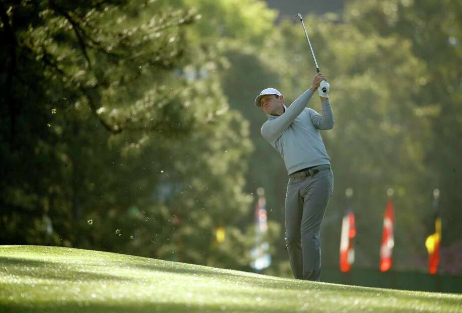 Matt Parziale hits from the fairway on the first hole during practice for the Masters golf tournament at Augusta National Golf Club, Monday, April 2, 2018, in Augusta, Ga. (AP Photo/Charlie Riedel) Photo: Charlie Riedel, STF / Copyright 2018 The Associated Press. All rights reserved.