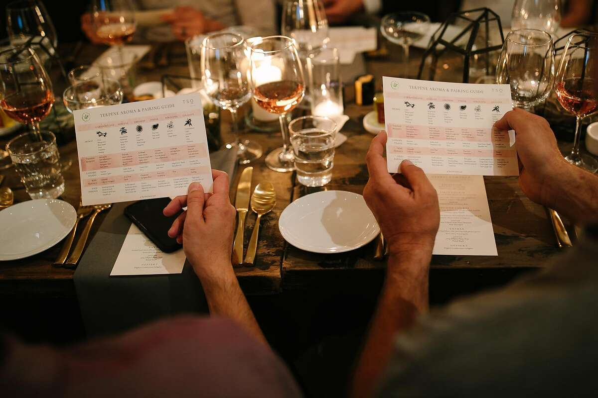 Guest look at the a terpene aroma and tasting pairing guide before partaking in the TSO Sonoma's event in San Francisco, Calif. Saturday, Feb. 10, 2018.