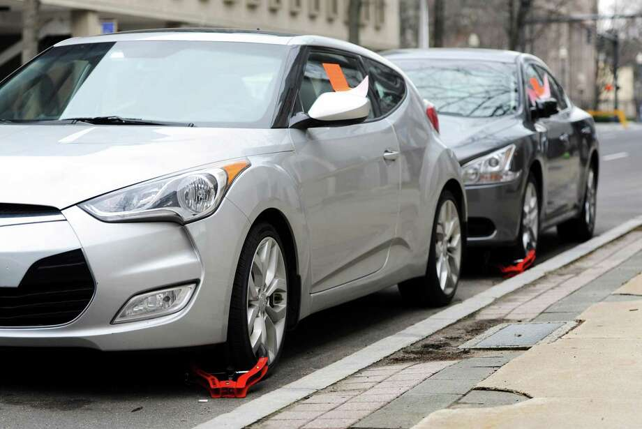 Cars on State Street in Bridgeport, Conn. were booted with wheel locks on Thursday, March 17, 2016. Photo: File Photo / Cathy Zuraw / Hearst Connecticut Media / Connecticut Post