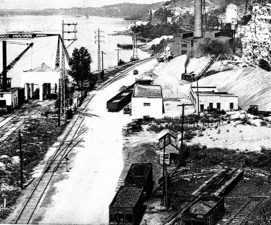 In 1938, industry along the river was thriving. The Union Electric Power Plant and Mississippi Lime Company are seen here with the beginnings of what is now the scenic McAdams Highway. Views of the river and bluffs are always impressive, even when viewed through a maze of wires and utility towers. Photo: File Photo