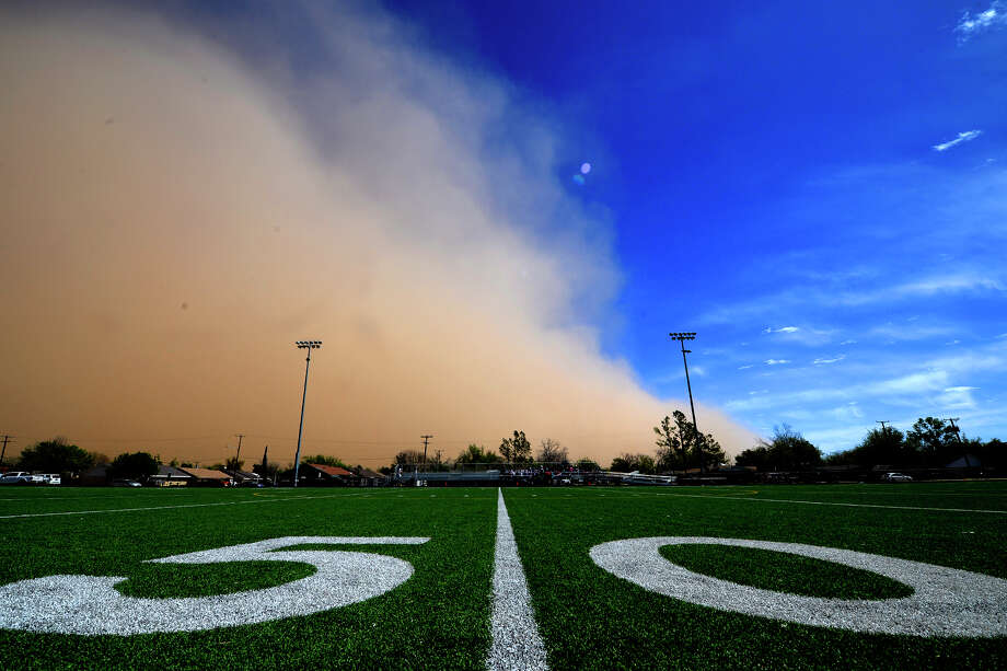 A dust storm approaches the football field at Lee High School, April 3, 2018. James Durbin/Reporter-Telegram Photo: James Durbin
