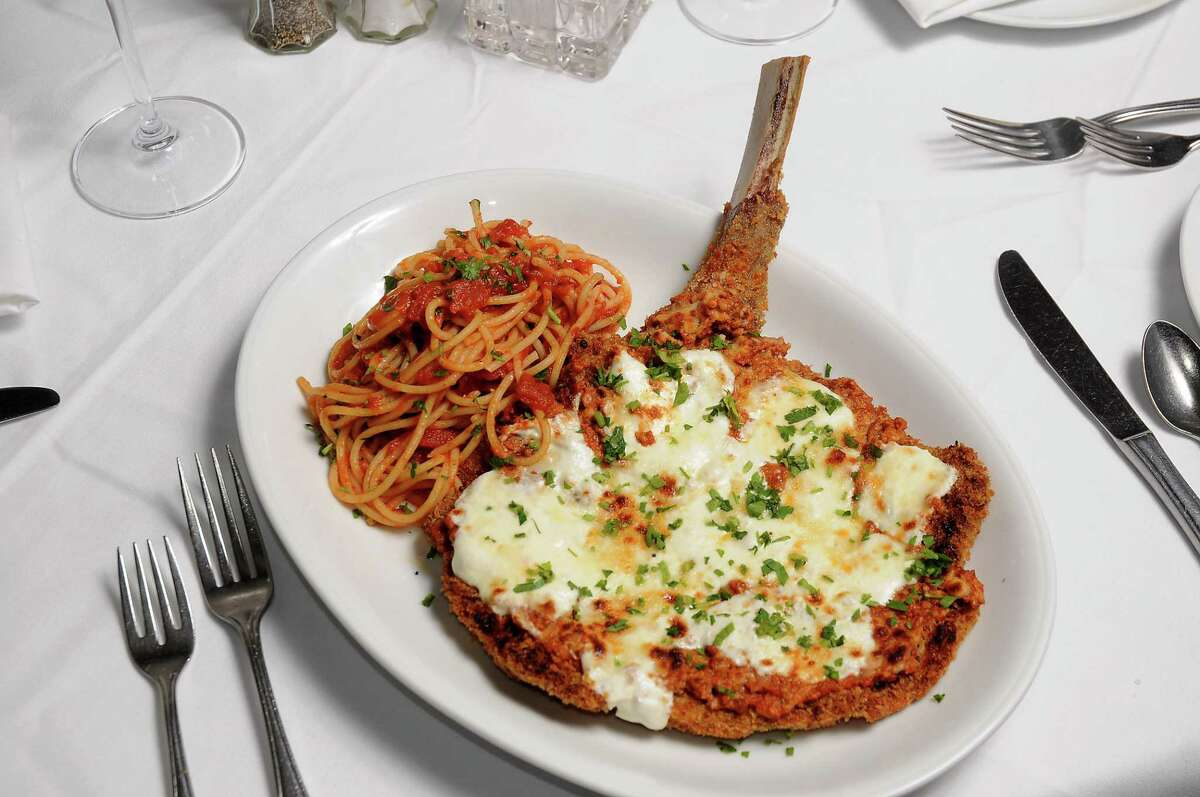 Bone-in veal parmigiana with pasta pomodoro at Carmelo's Cucina Italiana.