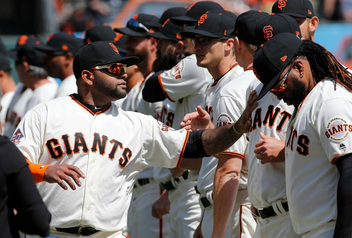 Giants' Pablo Sandoval is introduced during the home opener for the San Francisco Giants as they prepare to take on the Seattle Mariners at AT&T Park in San Francisco, Calif., on Tues. April. 3, 2018.