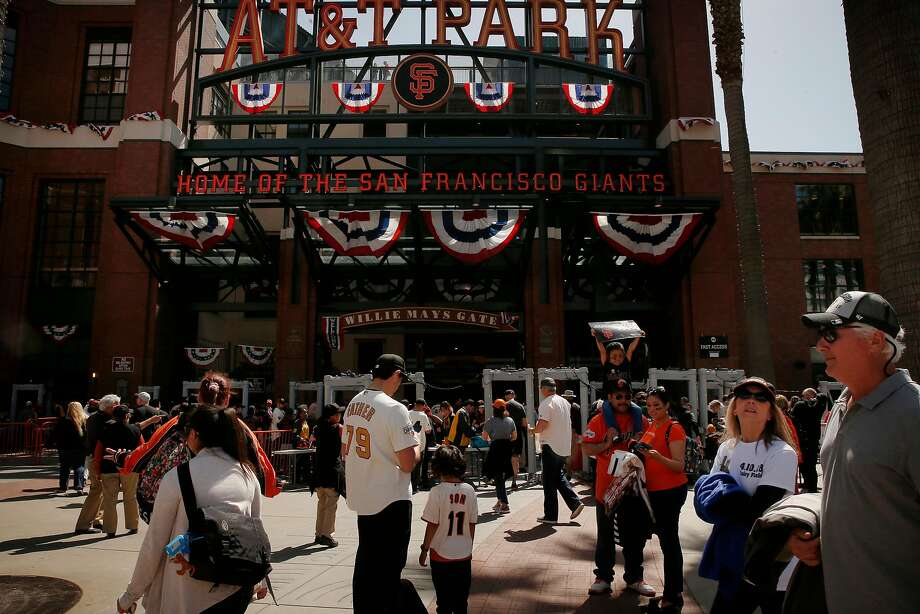 Fans make their way into AT&T Park before Tuesday's Giants home opener. Photo: Santiago Mejia / The Chronicle