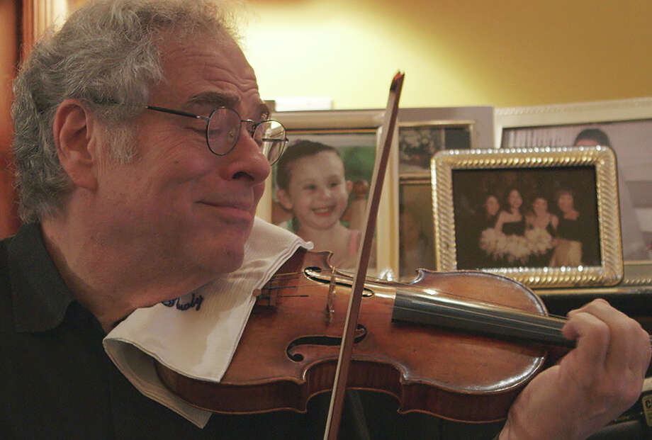 Violinist Itzhak Perlman, seen at home, is the subject of a new documentary. Photo: Greenwich Entertainment / Greenwich Entertainment