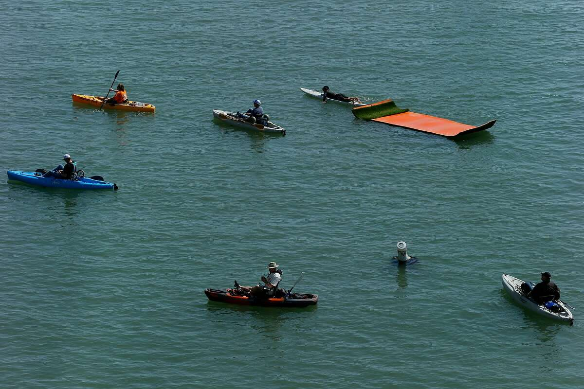 People at McCovey Cove during opening day before a baseball game between the San Francisco Giants and Seattle Mariners at AT&T Park, Tuesday, April 3, 2018, in San Francisco, Calif.