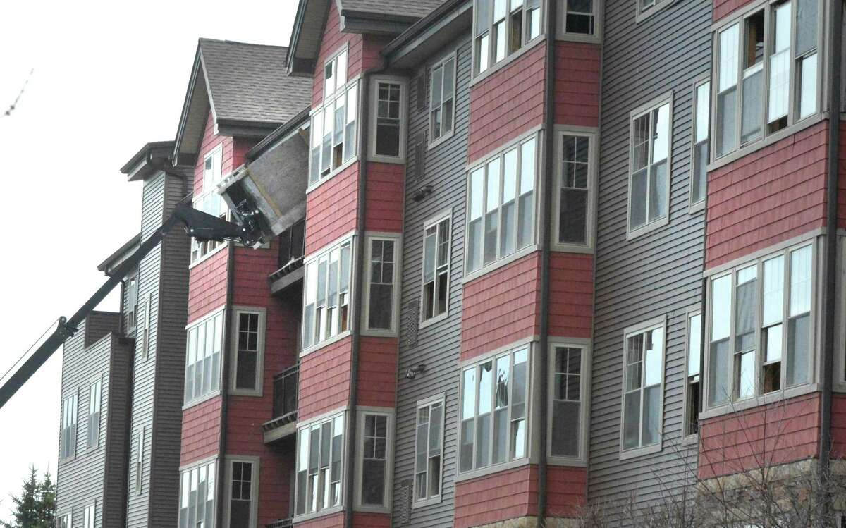 A lift is used to get to a top floor during construction at the Stonewood condominium complex on Richards Ave. on Wednesday March 28, 2018, the building was heavily damaged in a December 11 fire in Norwalk Conn.