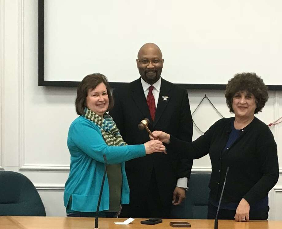 Outgoing Republican Town Chairwoman Michelle Gregorio, right, hands off the gavel to newly-elected Republican Republican Town Chairwoman Patricia Libero, left. They are joined by Steven R. Mullins, center, who served as interim chairman. Photo: Contributed Photo / State Rep. Charles Ferraro